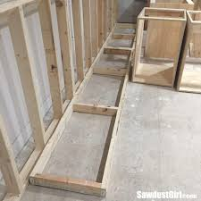 how to raise cabinets the floor building a wall the craft room cabinets sawdust