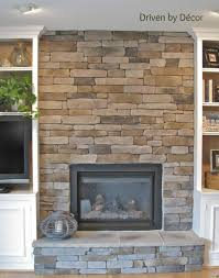 interior majestic stone veneer fireplace with nice wooden mantel