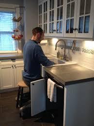 raising kitchen base cabinets working in the kitchen