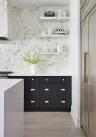 brass and black kitchen cabinet hardware black kitchen cabinets with polished brass cup pulls
