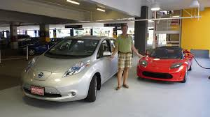 nissan leaf vs tesla going for a ride in a tesla roadster showcase for a green