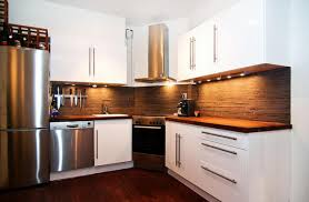 backsplash ideas for white cabinets and dark countertops