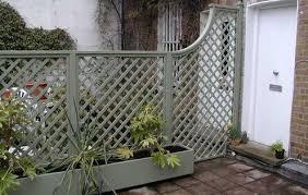 Wooden Trellis Panels Trellis Garden Fence And Planter Is A Soft Lichen Grey Green The