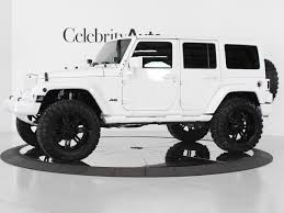 white jeep wrangler unlimited lifted white 4 door jeep wrangler i prefer the black top but i like