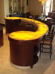 curved sapele kitchen bar with underlit onyx bartop miserv curved sapele kitchen bar with underlit onyx bartop