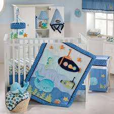 white wooden cradle with blue submarine blanket plus white wooden