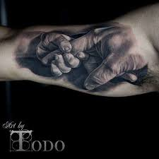 baby holding dad u0027s finger realistic tattoo on bicep by todo
