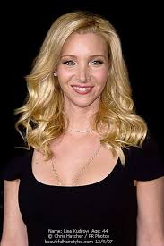 hair styles for black women age 44 lisa kudrow aged 44 in black dress with long wavy blonde hair style