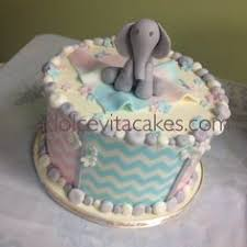gender reveal cake and have one elephant with pink one with blue