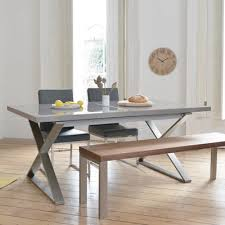crossed leg gloss extending dining table stone dwell