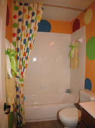 colorful polkadot on yellow wall paint curtain white porcelain