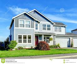 big two story house view of entance porch and garage stock photo