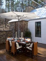 Patio Sets With Umbrellas by Furniture Ideas Patio Dining Set With Umbrella And Wooden Deck