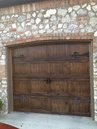 metal garage doors painted to look like wood with fluer de lis