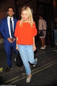 sienna miller leaves london u0027s apollo theatre in orange daily