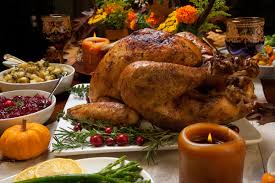 thanksgiving table with turkey grilled turkey and candles on the thanksgiving table stock photo