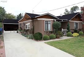 home exterior decoration with earth tone color wall paint and roof