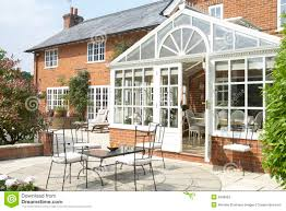 exterior of house with conservatory and patio stock image image
