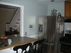 the wall color is sherwin williams sw 7567 natural tan latex