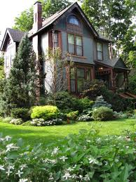 classic and beautiful garden in a front yard landscape of a mid