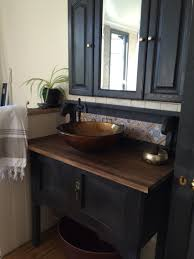 black bathroom vanity made from an old washstand porters chalk