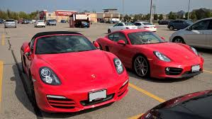 porsche boxster red two guards red cars side by side 981 boxster vs 981 cayman