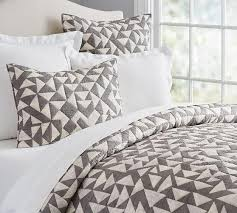 triangle bedding print quilt and sham in white and grey