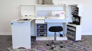 craft cabinet with fold out table fold out sewing table with storage furniture pinterest storage