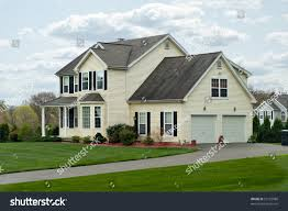 building a two car garage modern colonial style residential suburban home stock photo