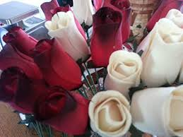 wooden roses 2 dozen wooden roses with black tip creme colored