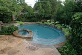 small backyard pool landscaping ideas with wooden pallet fence and