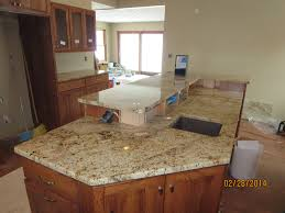 choosing a kitchen faucet granite countertop glass for kitchen cabinets inserts mirrored