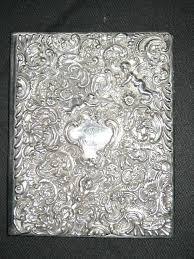 silver photo album one striking vintage photo album with cherub ornate sterling