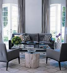 blue and gray living room color of the week dovetail gray wood side tables elle decor and