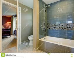 simple yet modern bathroom interior with tile wall trim and