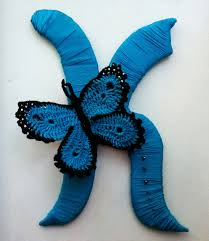wraped yarn letter k with crochet butterfly crochet and sewing