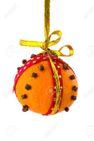 orange with cloves for hanging at golden ribbon stock