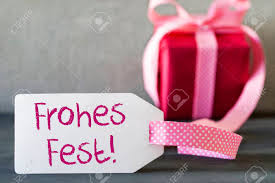 pink gift label frohes means merry stock photo