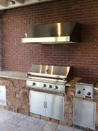 designing an outdoor kitchen vs indoor hi tech appliance