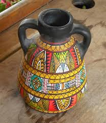 black flower pot with hand painted warli painting terracotta