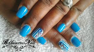 easy blue and white nail art ploish design with bling on acrylic