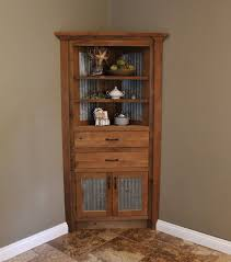 curved brown wooden corner cabinet with ivory shelves and double