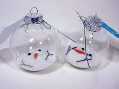 this ornament is so a melted snowman including stick arms