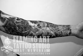 and demons tattoos and demons fighting sleeve