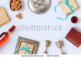 bitter herbs on seder plate passover frame composition wine stock photo