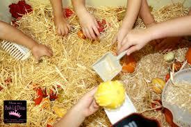 to 2 posh lil divas fall themed sensory table in preschool