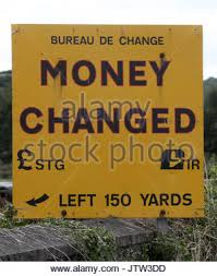 newry bureau de change a currency exchange sign at the border between the republic of stock