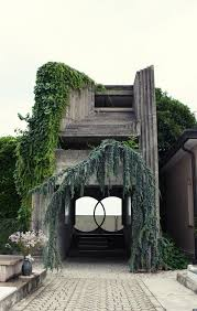 from the earth to heaven and back carlo scarpa cemetery and stone repetition at ninety degree angles stunning overgrown vines italian architect carlo scarpa