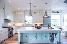 white kitchen cabinets with blue island coastal style white kitchen with blue island cabinets