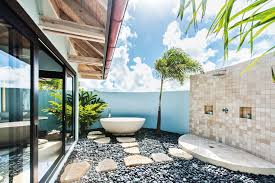 incredible outdoor bathroom ideas with neutral green plant and amazing outdoor bathroom ideas with round shape white bathtub and black stone gravel field area